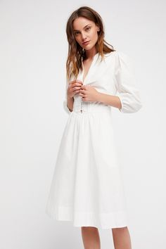 Summer Winds Midi Dress | **Fit:** Fitted waist.  Cotton midi dress featuring an easy, effortless shape and pleated detailing in front with button closures.    * Side pocket details   * Lined   * Quarter-length sleeves with elastic at the cuffs   * Hidden side zipper closure