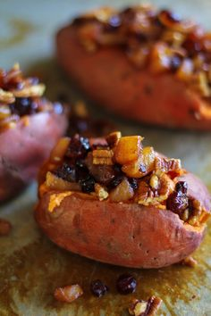 Stuffed Sweet Potatoes with yogurt, honey, cinnamon, caramelized pears, pecans, and dried cranberries - a healthy and filling side dish #recipe #paleo #vegetarian