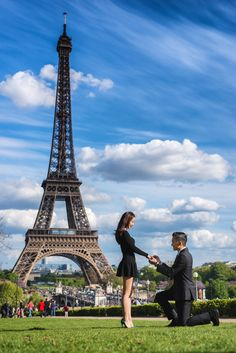 Fashionable girl in a beautiful very short black dress says YES to the men she loves. Surprise proposal in Paris captured by Fran Boloni, Paris engagement photographer