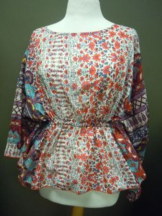 Ivy Jane Floral Top! Great now with some white jeans or Fall with Chocolate Brown!!! $147.50