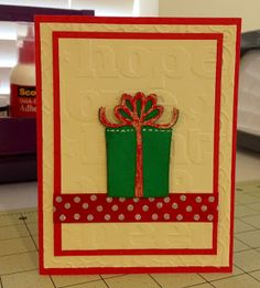 "A2 sized card.    Mat 1 (beige) = 5.25"" x 4""; embossed with Cuttlebug ""Heritage"" folder.  Mat 2 (red) = 4.75"" x 3.5""  Mat 3 (beige) = 4.5"" x 3.25""; embossed with Cuttlebug ""Joy and Cheer"" folder.    Gift image = cut at 2.25"" from Cricut Joys of the Season cartridge;  on page 56 of folder.  White gel pen stitching added.  Image has been mounted using foam tape.    Ribbon on image has stickles added first, then overlayed with Glossy Accents.    Ribbon on card = Christmas ribbon found at Mic"