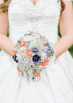 #broochbouquet #coralwedding #coralnavybouquet Cascading Bridal Brooch Bouquet. Coral, Navy, White and Crystal Brooch Bouquet Photography by The McElmurrys https://www.etsy.com/listing/260814045/deposit-on-custom-made-cascading-bridal www.secretgardenbouquets.com