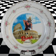 ROMAN ROBOT HOLIDAY-upcycled vintage china plate. Over 10 inches in diameter, this Japanese porcelain plate has a border of delicate rose bouquets and a gilded rim. The traditional 'postcard from Italy' design gets a modern re-boot in vintage Mod style. Romulus and Remus and Robby do Roma!  (oh yes she did!)