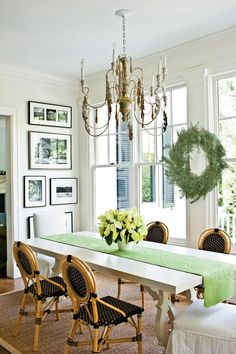 This table is complemented by the slipcovered chairs and French-style bistro chairs that have plastic seats and backs, keeping things stylishly practical.