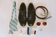 love the picture of the groom's accessories, too!
