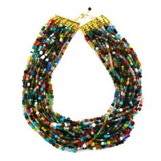 dying to find a bright, colorful beaded necklace like this, elva fields.