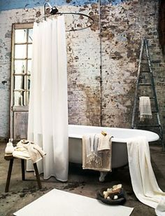 Love the rustic exposed bricks and shabby vintage claw foot tub #home decor