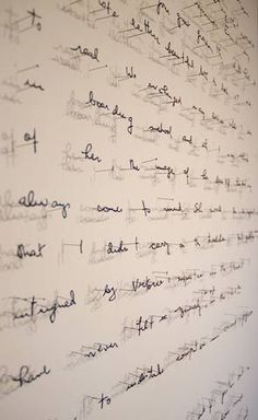 Paper cut letters suspended by pins by Annie Vought