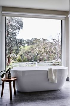A freestanding bathtub at a newly built farmhouse at Red Hill on Victoria's Mornington Peninsula enjoys sweeping bushland views Country Style Homes, French Country Style, French Country Decorating, Bathroom Red, Bathroom Interior, Red Bathrooms, Bathroom Vanities, Luxury Bathrooms, Glass Bathroom