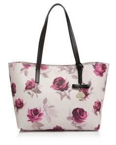 Longer-lasting than a dozen roses, this roomy, printed kate spade new york shopper is every bit as dreamy. | Polyvinyl chloride; trim: leather | Imported | Double handles  | Clasp closure; unlined  |