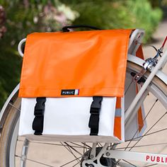 I may not be so into bicycling (a fact my mother laments- she is) but I love this double pannier. So bright.