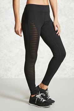 An athletic pair of leggings featuring striped mesh panels and moisture management. Forever 21