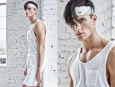 Dan wears bandana stylist's own, tank and shorts Topman.