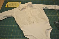 Make little boys white dress shirt stay tucked in by adding a onesie bottom!