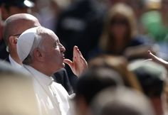 Pope Francis blows kiss during weekly audience at Vatican  Pope Francis blows a kiss as he arrives to lead his his weekly audience in St. Peters Square at the Vatican May 8. (CNS photo/Stefano Rellandini, Reuters)