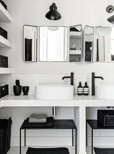 White tiled simple bathroom with vintage mirrors