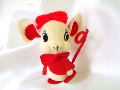 Vintage white flocked plastic mouse is quite the flirt! She has a red jacket and yarn hair bow and her ears are accented with red. The eyes are stickers and her nose a plastic bead. The red tail is wired and she has cardboard feet. There is a gold hanging loop.  She is 3.25 inches (8.3 cm) tall.  Made for Lee Wards in Japan.  Condition: Excellent - flocking is slightly yellowed on face.  Check here for more plastic ornaments: http://www.etsy.com/shop/bythewaysidexmas?section_id=15787776…