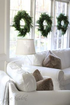 minimalist evergreen wreaths hanging on the windows look very chic and festive and don't bring excessive glitter or colors Minimal Christmas, Simple Christmas, White Christmas, Christmas Home, Vintage Christmas, Christmas Ideas, Christmas Villages, Victorian Christmas, Holiday Ideas