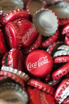 I think it would be super cute to save all the coke tops from the wedding and then make them into the letter of your new last name! <3