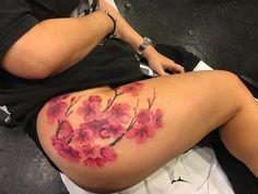 Cherry Blossom tattoo upper thigh.