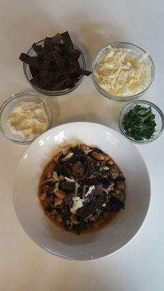 Serve your dish: Top with the toasted tortilla strips, cheese and sour cream. Garnish with the cilantro. Enjoy!