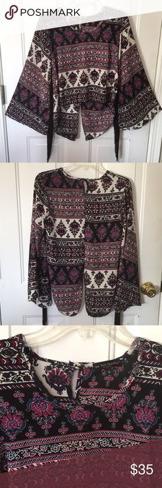 """High Low Blouse by See You Monday Sz S High Low Hippy Boho Blouse with Long Fringed Bell Sleeves High Cropped Front Long Back with 9"""" Slit Scoop Neck In a Burgundy Black Ivory and Navy Floral Print Size S 100% Polyester NWOT Made in USA See You Monday Tops Blouses"""