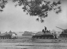 """bmashina: """"Column of Soviet self-propelled artillery SU-85M from the 7th guards tank corps 3rd guards tank army with infantry to armor in anticipation of the March. In the background heavy..."""