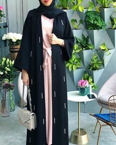 Long pink dress paired with black abaya Modern Abaya, Modern Hijab Fashion, Arab Fashion, Dubai Fashion, African Fashion, Hijab Gown, Mode Turban, Moslem Fashion, Outfit Look