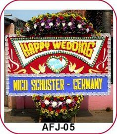 kirim Bunga Papan happy Wedding ke Hotel Ibis Jakarta Slipi Mengucapkan selamat dengan Bunga Papan Happy wedding.  Pernikahan atau hari pern...