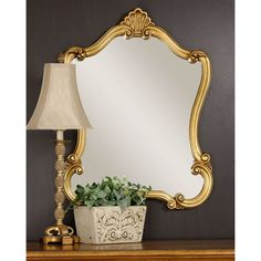 Traditional luxury meets modern functionality in the Darby Home Co. Romero Wall Mirror. Challenging conventional designs, this mirror lets you make a bold statement within your home-space. It has a grand design, which is reminiscent of Baroque styled furnishing of the era long past. The traditional design of the mirror allows you to furnish the room with similarly themed creations for the perfect look. The mirror is best suited for entryways and hallways to exude panache, and can also be…