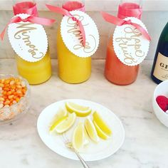 "Mimosa anyone? How cute and clever is this mimosa bar friend @juliebraun put together for her annual ""Momosa"" back-to-school party - love the calligraphy tags and mimosa-flavored jelly beans! #party #brunch #mimosas #mimosabar #partyideas #talentedfriends #cheers"