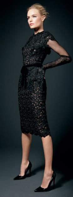 Kate Bosworth in Tom Ford black lace cocktail dress with elbow length gloves.