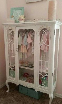 Turn a VINTAGE CHINA HUTCH into a BABY CLOSET...this is such a great idea! So pretty! What do you think?