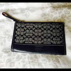 Mini Coach wallet Black mini wallet from Coach with key ring. Great condition! Coach Bags Wallets