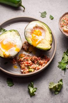 These baked huevos rancheros avocados are an easy, fresh, and light vegetarian low carb breakfast or snack idea.