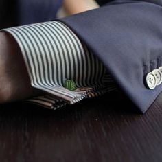 I'm crazy about a guy's cuff hanging below his suit jacket. It says he knows how to dress himself. Biddy Craft