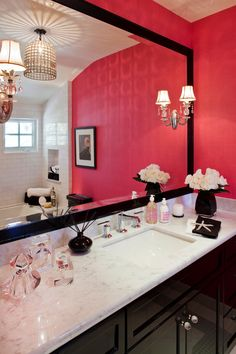 Girly bathroom, cute, elegant and pretty! I like the combination of warm paint, dark wood and white marble