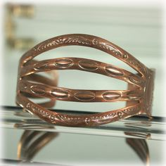 Solid copper unsigned cuff bangle bracelet from Bell Trading Company. Estimate age is the 1960s (Bell operated between 1935 until the 80s). It