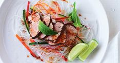 Fresh pickled vegetables with vermicelli noodles and aromatic Asian-spiced pork is a great way to add protein to a fresh meal.