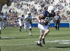 PENN STATE – FOOTBALL 2014 – BLUE/WHITE GAME, APRIL 12, 2014 – Penn State wide receiver Matt Zanellato hauls in a pass and runs for a touchdown during the annual Blue-White game, April 12, 2014, at Beaver Stadium. Joe Hermitt, PennLive