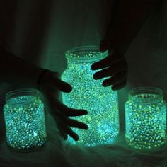 Glow in the dark paint dotted on the inside of jars