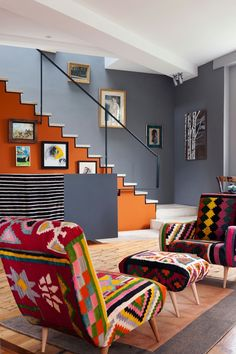 look at the pop-art effect created by the black line of trim outlining the orange stair in 3-D effect against the grey wall-