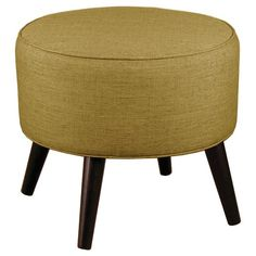 • Charming, mid-century modern style<br>• Espresso colored, round cone legs<br>• Pure cotton upholstery<br>• Cute, compact size<br>• Supportive Dacron foam fill<br>• Sturdy wood frame<br>• Maximum weight capacity: 200 lbs.<br>• Spot clean only<br><br>Kick back and relax with a Threshold, Round Cone Leg Ottoman. This round footrest perks up any room with its vintage-ins...
