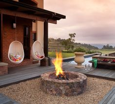 Sitting around an outdoor fire pit with loved ones, gazing at the warm flames under the starry night sky, life is just blissful and magical! As a home and garden designer, I see fire pit on almost … Diy Fire Pit, Fire Pit Backyard, Fire Pits, Backyard Retreat, Backyard Ideas, Outdoor Living Areas, Outdoor Spaces, Outdoor Decor, Outdoor Seating