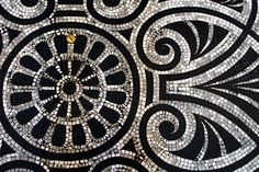 "The floor is of mosaic tiling with central geometric patterning and external borders. This border pattern is called a meander, which means, ""to wander"". The name was derived from the Meander River of Grecian times. The black and white colours were of"