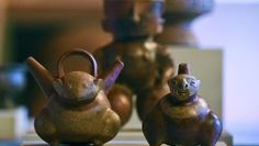 Pre-Columbian pottery pieces are exhibited during a press conference at the San Carlos Palace in Bogota, on September 1, 2014. (Photo: AFP)