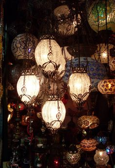 would love to get some eclectic lanterns to hang in a grouping over the end table at the end of the couch in the corner of the room.
