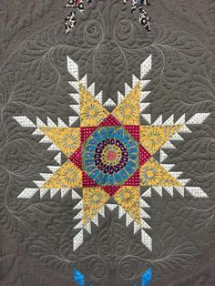 close up, Feathered Star by Lisa Curnutt won First Place in Novelty Custom. 2015 HMQS, Salt Lake City. Photo by Sew Fun 2 Quilt.