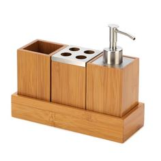 """Chic, modern and eco-friendly— those are just a few of the perks of this winning trio! Handsome bamboo water cup, soap dispenser, toothbrush holder and tray make a stunning addition to your bathroom countertop.Weight 1.4 lbs. UPC# 817216010873. Set: 8 1/4"""" x 3 1/8"""" x 7"""" high. Bamboo and stainless steel. Set"""