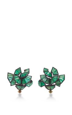 Modern and utterly feminine, these mesmerizing **Nak Armstrong** earrings harmonoiusly blend the designer's architectural background with Art Deco opulence, resulting in a unique and unexpected masterpiece.
